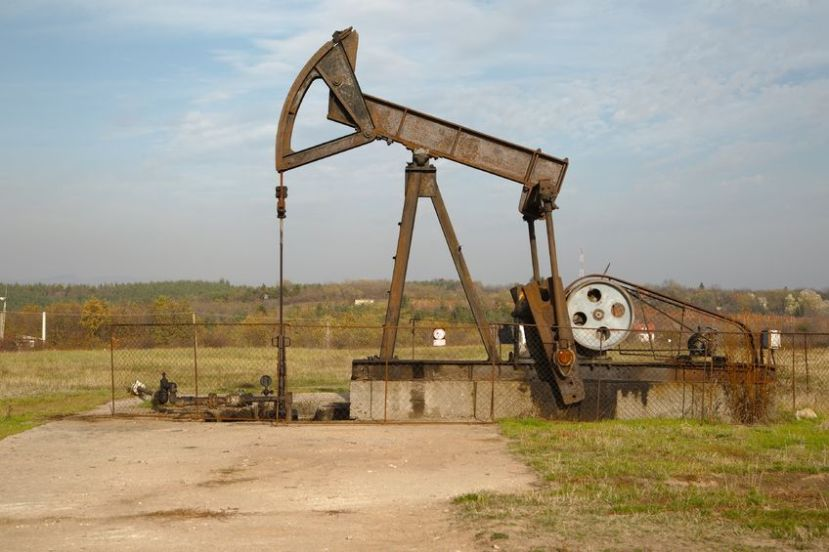 48883526 - old rusty oil well on a field
