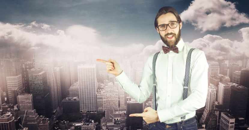 79252750 - digital composite of male hipster pointing against cityscape