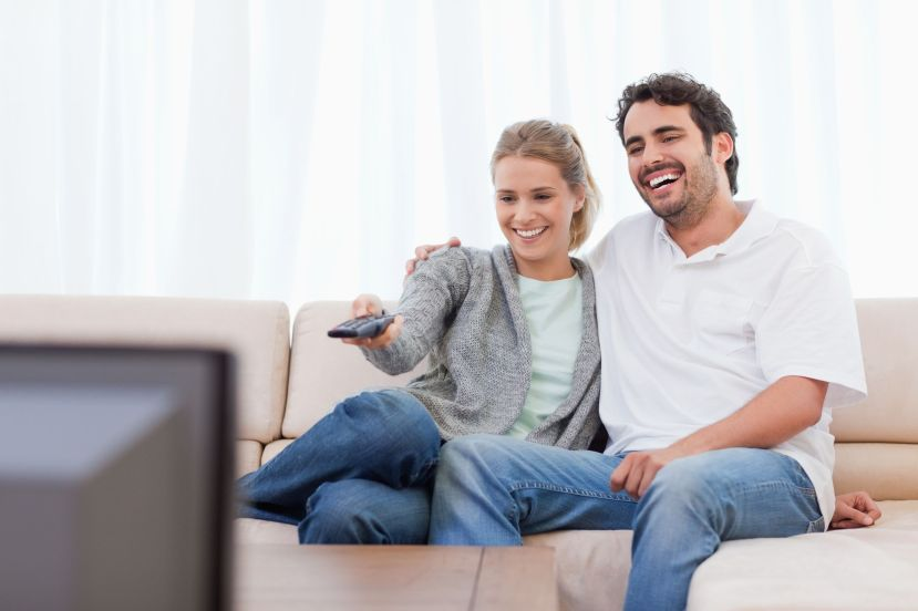 11683601 - couple watching tv in their living room